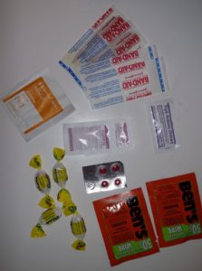 Simple first aid supplies, band-aids, disinfectant, insect repellent, throat lozenges, etc.
